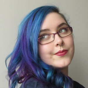 Headshot of Brittany with blue and purple hair